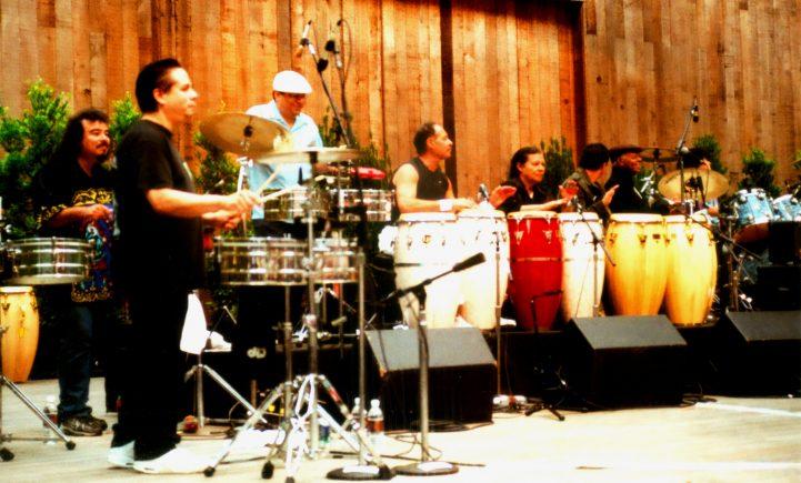 Marcos Reyes (War), Gibby (Malo), Areas, Michael Carabello (Santana), Chepito (Sanatana), Karl Perazzo (Santana), Armando Peraza (Santana) drummers - Legends of Latin Rock  (c. 2012)